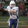 KEN YUSZKUS/Staff photo. Danvers' Nick Andreas looks for an open receiver as he readies to throw a pass during the Danvers at Marblehead football game. 9/5/14