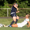 Danvers senior captain Emily Murphy, right, slides in to win a challenge against Swampscott sophomore Jaymie Caponigro, left, on Wednesday afternoon. DAVID LE/Staff photo. 9/3/14.