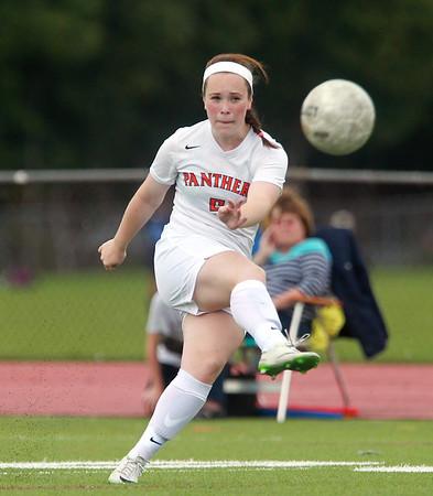 Beverly junior Sarah Visnick rifles a free kick just wide of the net against Peabody on Thursday afternoon. DAVID LE/Staff photo. 9/11/14.