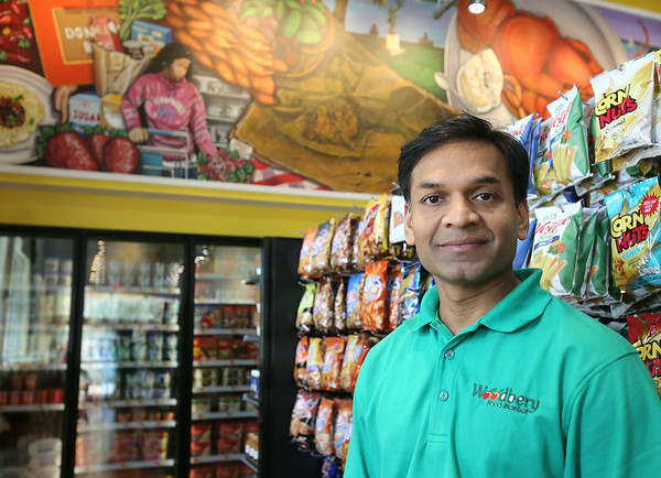 KEN YUSZKUS/Staff photo. Woodbery Market owner Amit Patel is inside his new store in Beverly, which opened on Aug. 20.  9/3/14