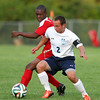 Peabody captain Christian Morales (2) fights for position and control of the ball with Salem striker Dalvin Alexandre, left, on Tuesday evening. DAVID LE/Staff photo. 9/9/14.