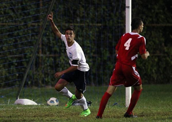 Peabody midfielder Joao Correia (17) celebrates his first half goal off a free kick. DAVID LE/Staff photo. 9/9/14.