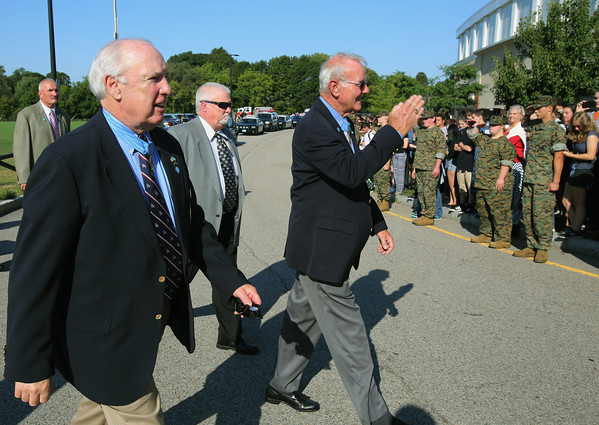KEN YUSZKUS/Staff photo.  Congressional Medal of Honor recipients James Taylor, left, and Robert Patterson saluting just arrived at Beverly High School by helicopter.   9/16/15.