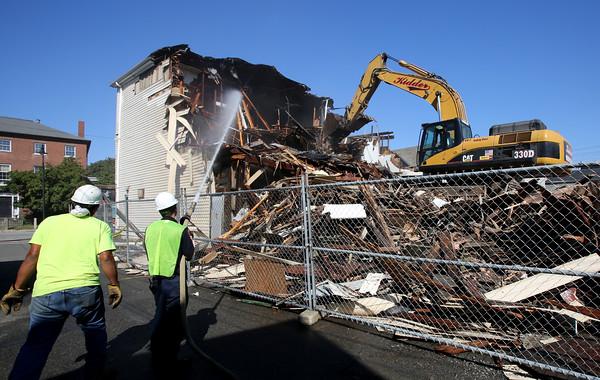 KEN YUSZKUS/Staff photo.   Demolishing the old Salem Plumbing Supply building on Bridge Street in Salem.    9/17/15.