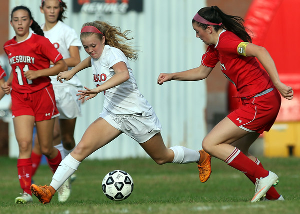 DAVID LE/Staff photo. Masco junior forward Nikki Arrington (9) tries to carry the ball upfield while being pursued by Amesbury captain Julia LaMontagne, right. 9/27/16.