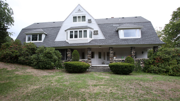KEN YUSZKUS/Staff photo  The house formerly owned by the Order of Carelites that is up for sale in Peabody.    09/08/16
