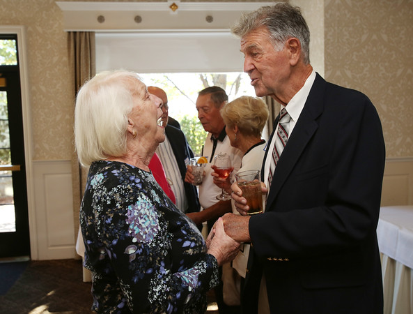 KEN YUSZKUS/Staff photo.     Graduates from Danvers' 1951 Holten High School, Betty Bates of Danvers, and class president Dick Vaux of Hampton Falls, NH, converse at their 65th reunion held at Danversport Yacht Club.    09/13/16