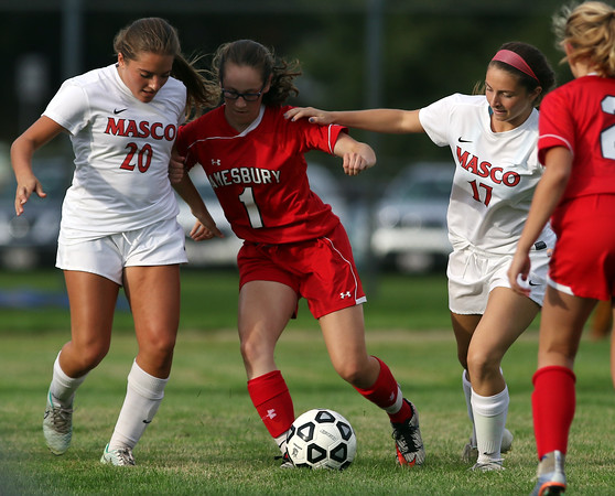 DAVID LE/Staff photo. Amesbury junior Schuyler Snay (1) battles for possession of the ball with Masco's Ani Nazarian (20) and Mack Saitta (17). 9/27/16.