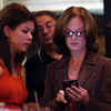 DAVID LE/Staff photo. Republican candidate for Essex County Sheriff Anne Manning-Martin, right, checks polling results with her campaign manager Jaclyn Corriveau, left, at her election party held at Kelley Square Pub in Peabody on Thursday night. Manning-Martin got the Republican nomination after beating out the other candidates. 9/8/16.