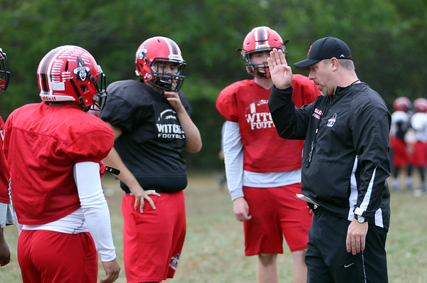 DAVID LE/Staff photo. Salem football head coach Matt Bouchard instructs his defense during practice on Wednesday. 9/28/16.