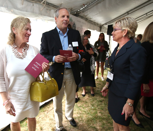 KEN YUSZKUS/Staff photo   President Mollyn Martins, right, speaks with Joan and Jeff Grady whose daughter Jane is a junior at the new school at the Ribbon-cutting of The Academy at Penguin Hall in Wenham.    09/06/16
