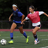 DAVID LE/Staff photo. Bishop Fenwick's Abby Rocker, left, and Gianna Capo, battle for the ball at practice. 9/27/16.