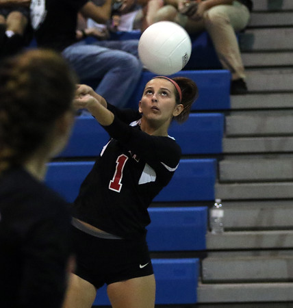 DAVID LE/Staff photo. Salem's Camryn Connolly concentrates while returning a volley against Peabody on Tuesday afternoon. 9/27/16.