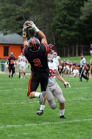 Photo/Reba Saldanha BHS's Kyle Chouinard catches a pass as Wakefied's Ryan Fitzpatrick tries to tackle him in Beverly's newly renovated Hurd Stadium Sept 10, 2016.
