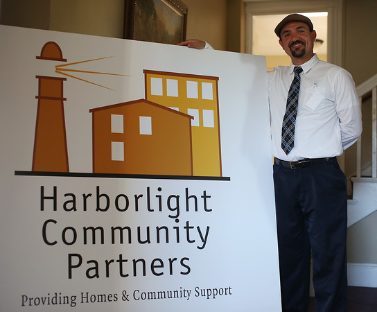 DAVID LE/Staff photo. Andrew DeFranza, of Harborlight Community Partners recently won a distinguished award for his work. 9/13/16.