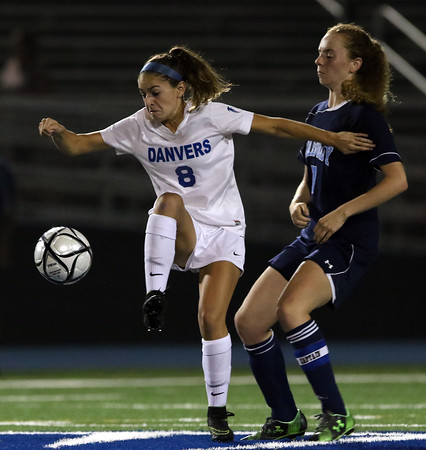 DAVID LE/Staff photo. Danvers junior Hannah Lejeune (8) tries to turn with the ball while being pressured by Peabody senior Katherine Scacchi. 9/20/16.
