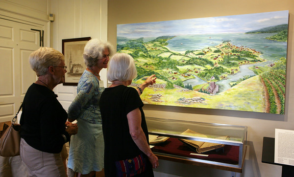 AMY SWEENEY/Staff photo.<br /> Mary Lou Ferriero, left, and Babette Loring talk with Avis Thomas, the artist of the painting they are looking at during the opening of a new exhibit by the Beverly Historical Society at the John Cabot House in Beverly.