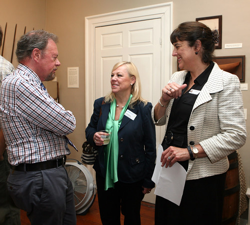 AMY SWEENEY/Staff photo.<br /> Dan Lohnes, left, president of the Beverly Historical Society, talks with Jo Broderick, center, and Director of the Beverly Historical Society Sue Goganian at the opening of a new exhibit by the Beverly Historical Society at the John Cabot House in Beverly.