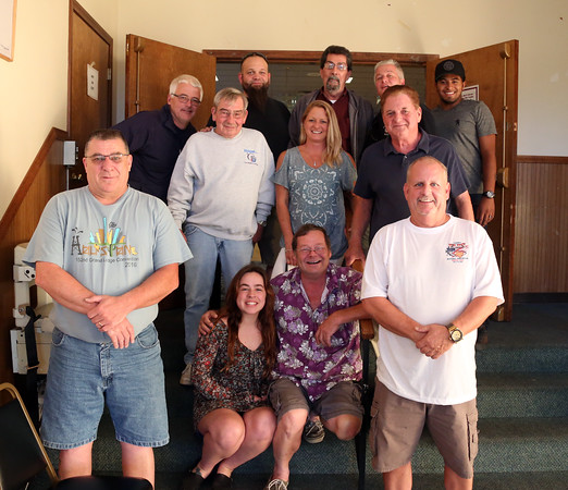 DAVID LE/Staff photo. A handful of volunteers who delivered dinners to local fire and police departments pose for a photo at the Peabody Elks club following the deliveries. 9/15/16.