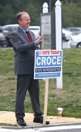 KEN YUSZKUS/Staff photo  State representative candidate Bob Croce waves to voters in cars entering the driveway of the polling place at Danvers High School.    09/08/16