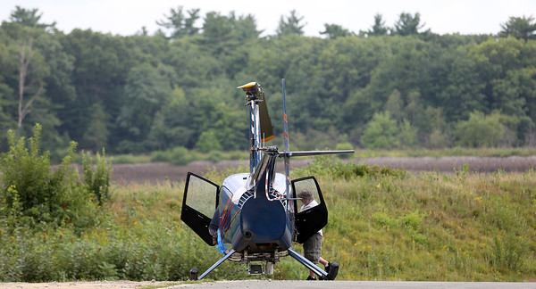 """DAVID LE/Staff photo. A helicopter made a """"precautionary landing"""" on Butternut Ave in Peabody on Thursday afternoon after experiencing some difficulties while out over the water. The chopper was headed back to the Beverly Airport when it made the landing. 9/1/16."""