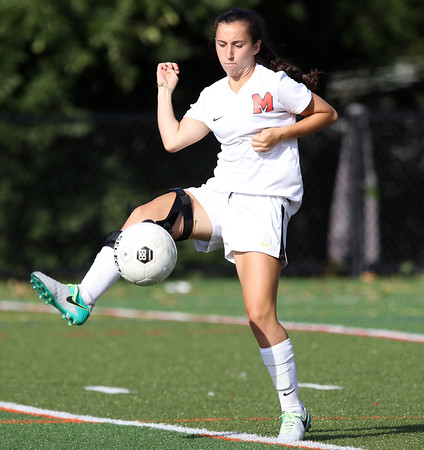 DAVID LE/Staff photo. Marblehead sophomore Lily Gregory controls a corner kick against Lynnfield. 9/8/16.