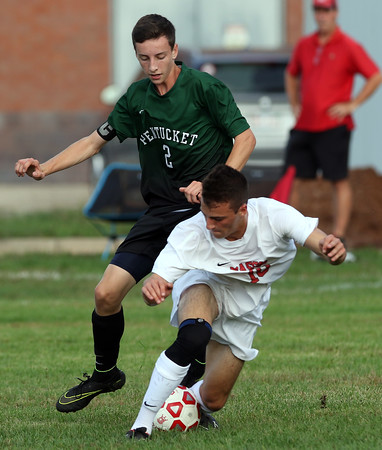 DAVID LE/Staff photo. Pentucket captain Jacob Deziel (2) and Masco senior Evan Glass get tied up as they battle for a loose ball. 9/20/16.