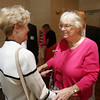 KEN YUSZKUS/Staff photo.     Graduates from Danvers' 1951 Holten High School, Pauline Schuman of Middleton, left, and Peggy Kingsley of Kennebunkport, Maine, greet each other at their 65th reunion held at Danversport Yacht Club.    09/13/16