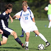 DAVID LE/Staff photo. Danvers' Jay McPherson cuts back and tries to create space as Swampscott captain Jack Dennehy (10) closes in. 9/8/16.