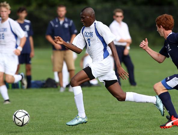 DAVID LE/Staff photo. Danvers' Sherak Ayamga carries the ball upfield against Swampscott. 9/8/16.