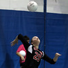DAVID LE/Staff photo. Salem's Sarah Starion (29) serves against Peabody on Tuesday. 9/27/16.