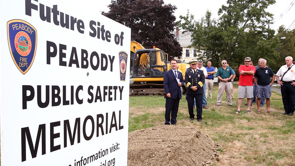 KEN YUSZKUS/Staff photo   People gather at the groundbreaking for the public safety memorial on Perkins Street in Peabody.    09/07/16