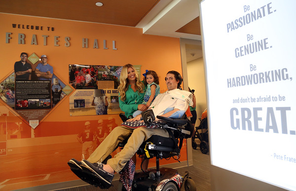 DAVID LE/Staff photo. Pete, Julie, and daughter Lucy Frates, inside the front hall of Peter Frates Hall on the campus of Endicott College in Beverly. 9/13/16.