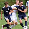 DAVID LE/Staff photo. Swampscott captains Jack Dennehy, left, and Jack Herlihy, right, sandwich Danvers' Jay McPherson as they make a play for the ball. 9/8/16.