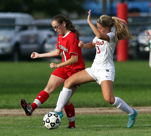 DAVID LE/Staff photo. Amesbury junior forward Schuyler Snay (1) plays the ball to a teammate while being pressured by Masco sophomore Athena Kordis (3). 9/27/16.