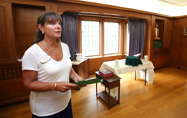 KEN YUSZKUS/Staff photo  Gail Tyrrell talks about the room's attributes while standing in the chapel of the house formerly owned by the Order of Carelites that is up for sale in Peabody.    09/08/16