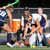 DAVID LE/Staff photo. Peabody's Ashlyn Fitzgerald, right, locks up sticks with Swampscott's Micaela Freddo during the first half of play. 9/15/16.