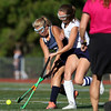 DAVID LE/Staff photo. Swampscott's Olivia Fillenworth, left, tries to take a shot while being contested by Peabody's Emma Bellavance, right. 9/15/16.
