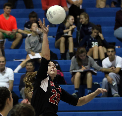 DAVID LE/Staff photo. Salem's Sarah Starion (29) smashes the ball over the net against Peabody on Tuesday. 9/27/16.
