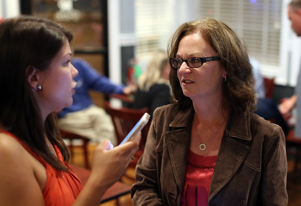 DAVID LE/Staff photo. Republican candidate for Essex County Sheriff Anne Manning-Martin, right, talks with her campaign manager Jaclyn Corriveau, left, at her election party held at Kelley Square Pub in Peabody on Thursday night. Manning-Martin got the Republican nomination after beating out the other candidates. 9/8/16.