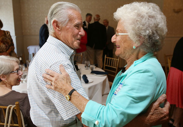 KEN YUSZKUS/Staff photo.     Graduates from Danvers' 1951 Holten High School, Ernie Bianco and Florence Woods, both of Danvers, greet each other at their 65th reunion held at Danversport Yacht Club.    09/13/16