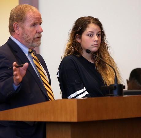 KEN YUSZKUS/Staff photo.    Emma Wiley at her arraignment in Superior Court.  Kevin Mitchell, left, is her attorney.     09/15/16