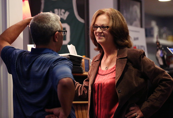 DAVID LE/Staff photo. Republican candidate for Essex County Sheriff Anne Manning-Martin, right, chats with a supporter at her election party held at Kelley Square Pub in Peabody on Thursday night. Manning-Martin got the Republican nomination after beating out the other candidates. 9/8/16.