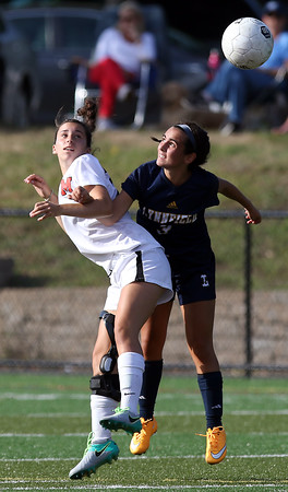 DAVID LE/Staff photo. Marblehead midfielder Lily Gregory wins a header in midair against Lynnfield on Wednesday afternoon. 9/8/16.