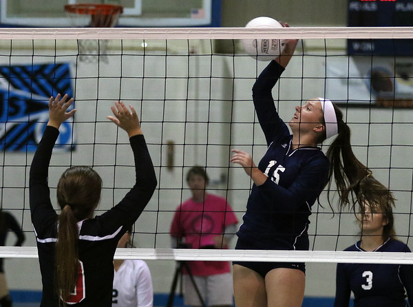 DAVID LE/Staff photo. Peabody's Bianca Chouinard smashes the ball over the net against Salem on Tuesday. 9/27/16.