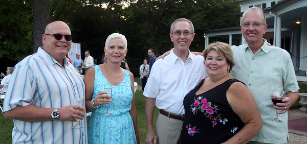 DAVID LE/Staff photo. From left, Amanda and Robert Smith, Don and Paula Gates, and Frank Gaffney, at the Danvers Historical Society's September Swings event held at Glen Magna Farms on Friday evening. 9/9/16.