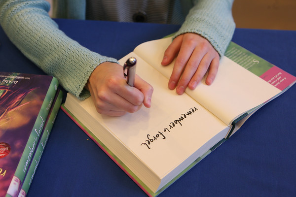 """AMY SWEENEY/Staff photo.<br /> Ashley Royer signs her book """"remember to forget"""" at Barnes & Noble in Peabody during a book signing."""