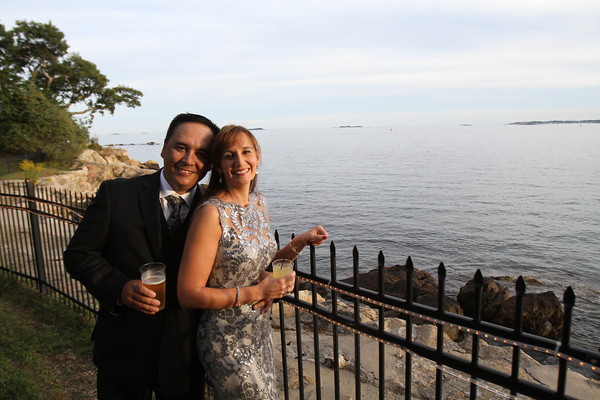 Renee Gauthier and George Carr of SeniorCare pose on a rear fence overlooking the ocean during the SeniorCare Gala dinner Wednesday, September 21, at Misselwood. Photo by Nicole Goodhue Boyd