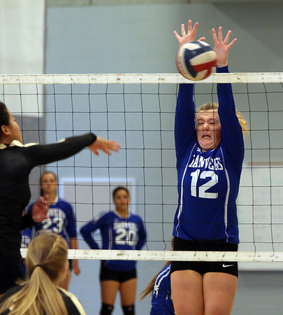 KEN YUSZKUS/Staff photo.    Danvers' Julia McNulty grimmaces as she blocks a shot at the net during the Bishop Fenwick at Danvers volleyball match.    09/12/16