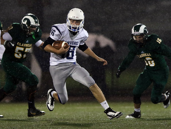 DAVID LE/Staff photo. Danvers quarterback Dean Borders makes a cutback as he breaks into the open field against Lynn Classical on Friday evening. 9/30/16.